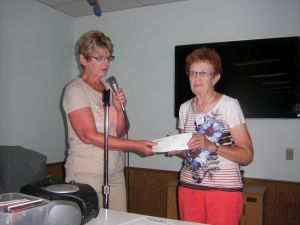 Alyce Heer (right)accepting MainStreams grant from Rose Weninger